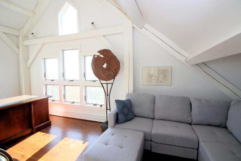 Second floor open balcony with expansive water views