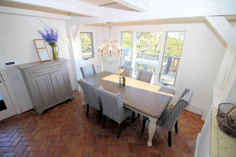 Lovely dining room overlooking deck and water beyond