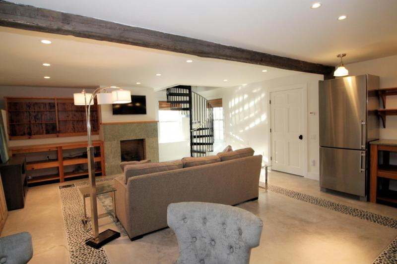 Guest house living area has comfortable furniture and half bath