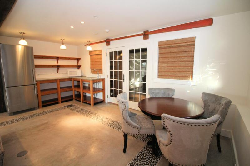 Guest house living area has table and kitchenette