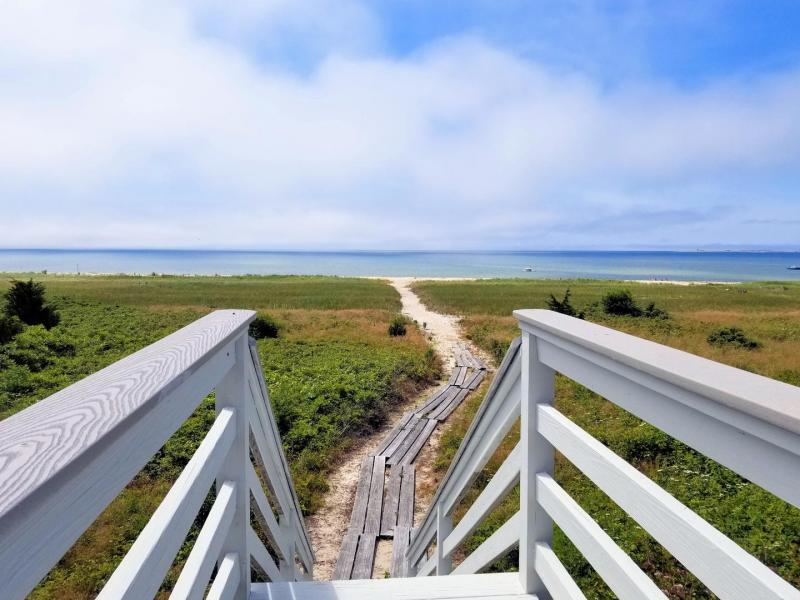 Stairs lead from property to direct path to the beach