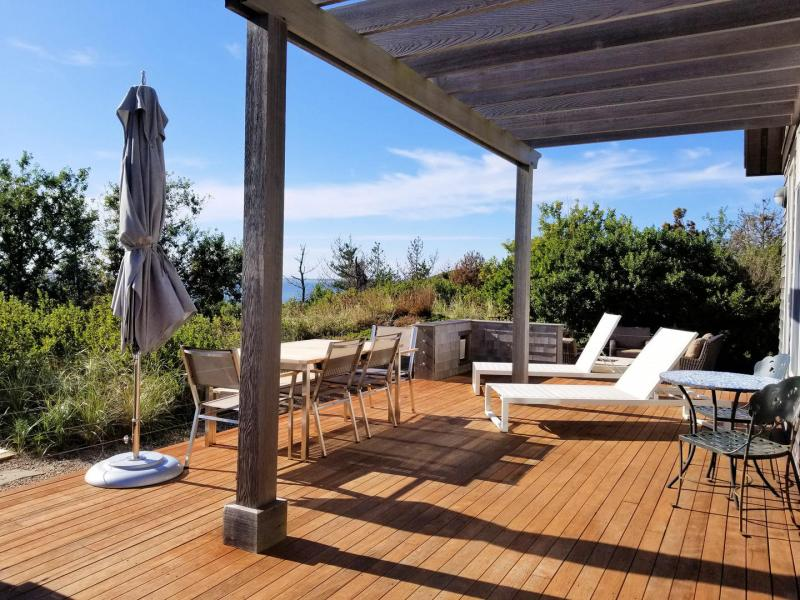 Spacious deck with furniture and gas grill