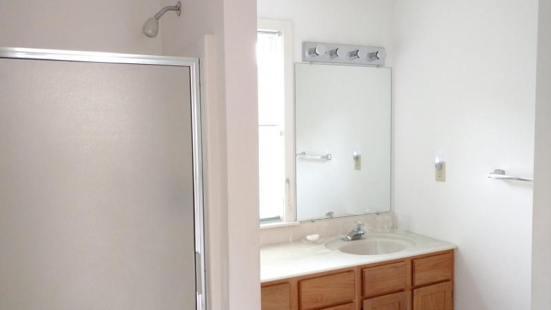 Master bathroom has separate tub and shower