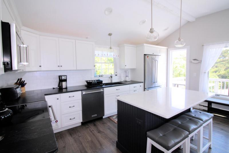 Kitchen has stainless appliances and is open and bright