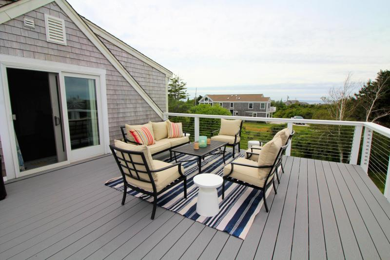 Large upper deck with outdoor furniture