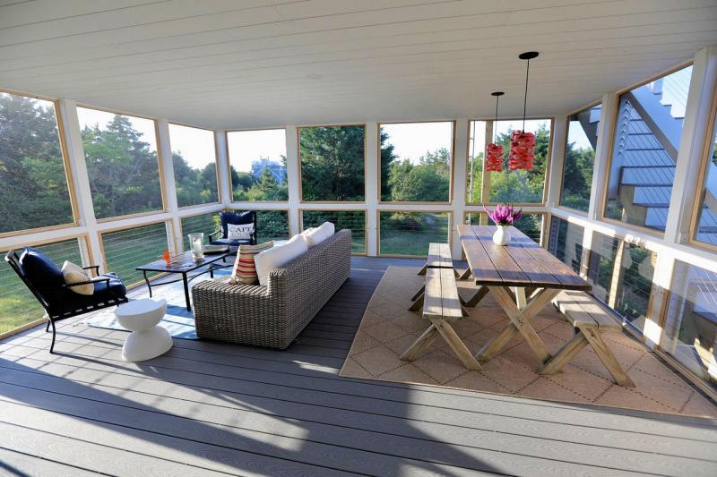 Beautiful screened porch with dining and lounging areas
