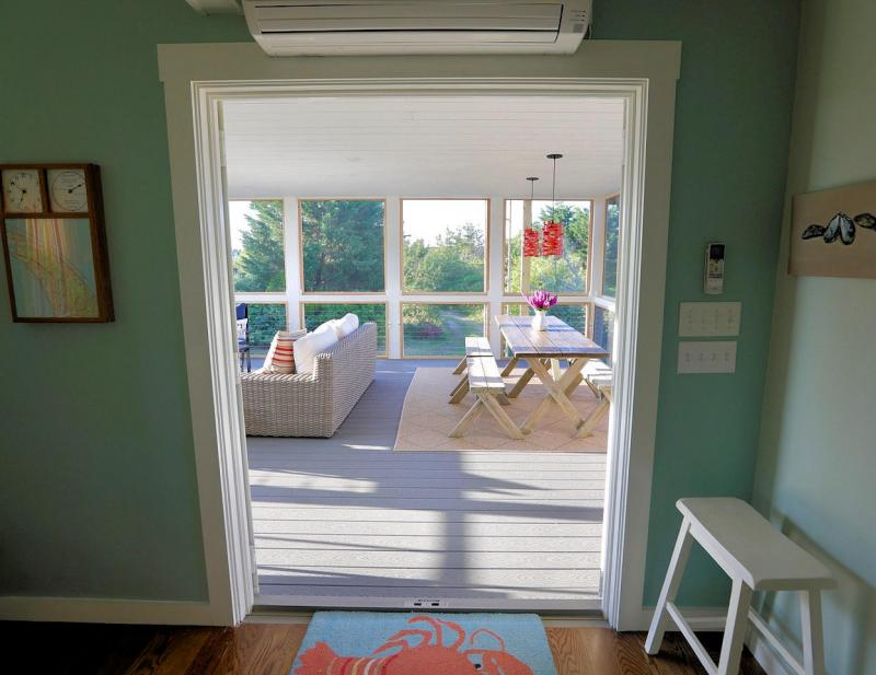 Door from living area leads to screened porch
