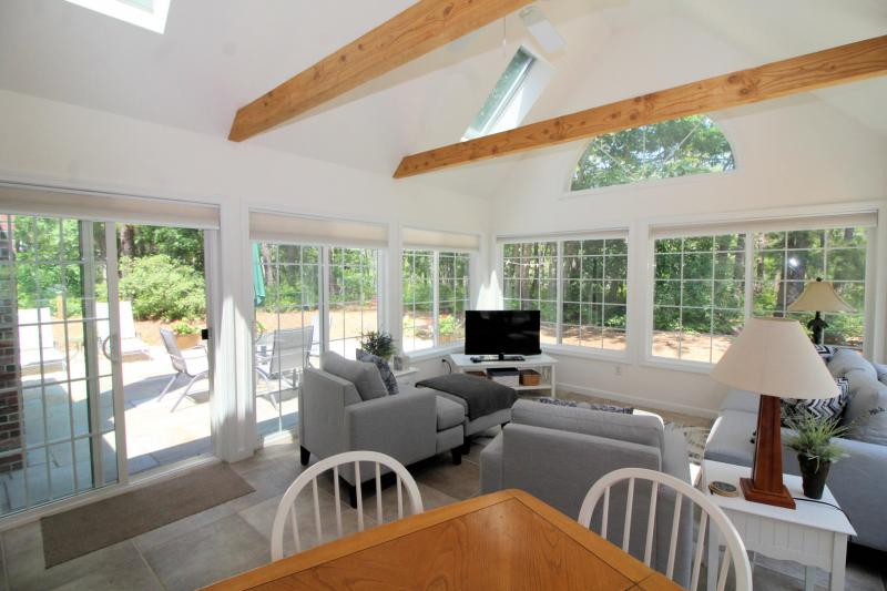 Light and bright sun room with flat screen TV