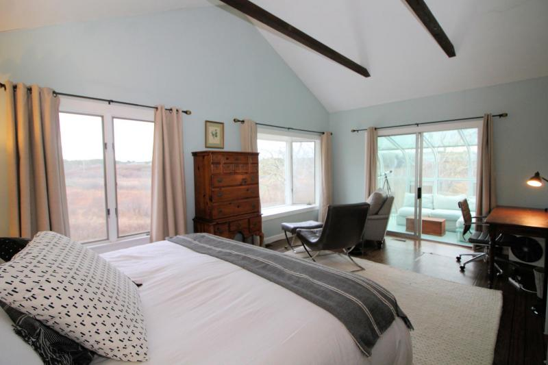 Master bedroom with king bed and sunroom