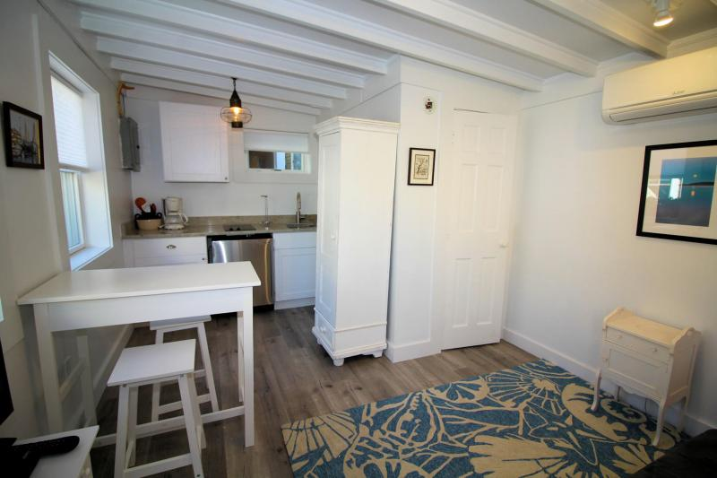 Kitchenette with granite counter tops and fridge