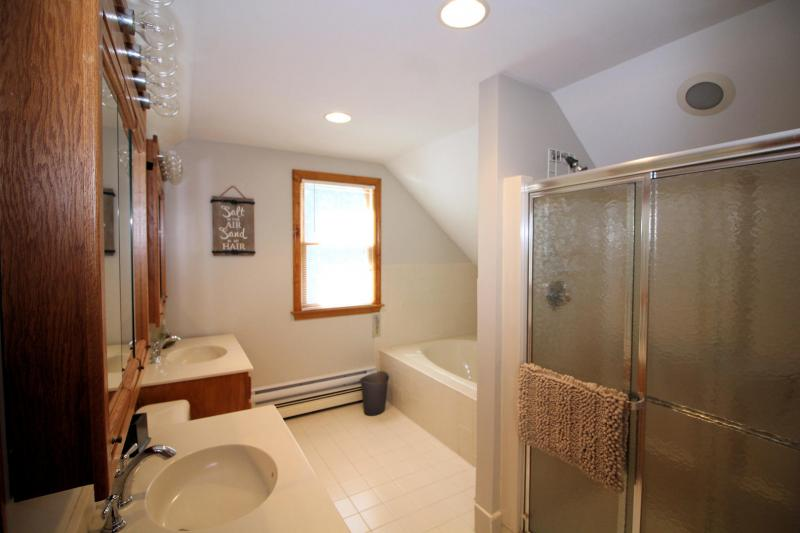 Second floor ensuite bathroom with tub and shower