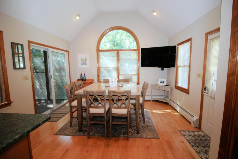 Slider from dining room leads to screened porch