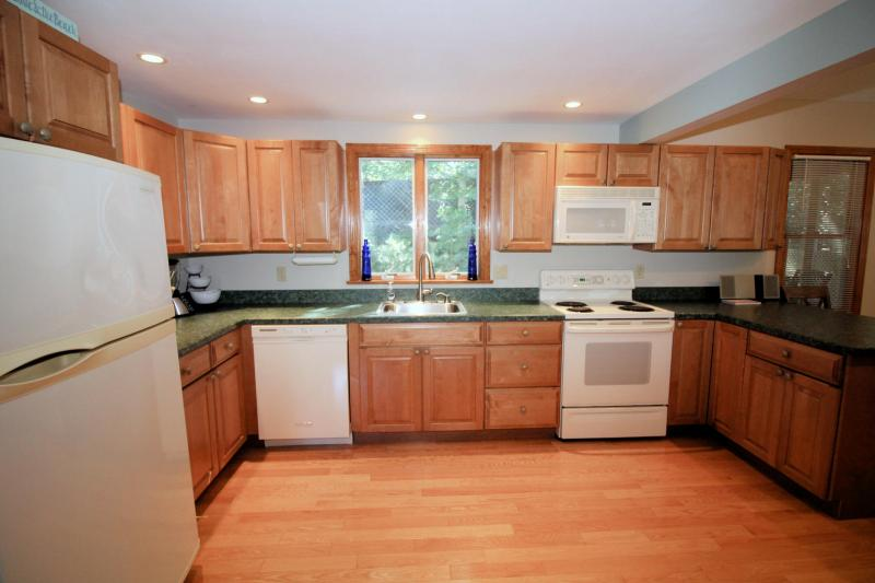 Spacious kitchen opens to living room