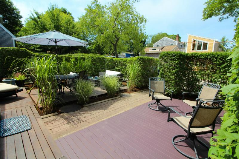 Front outdoor space has decking and a privacy hedge