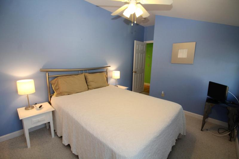 Second floor bedroom has ceiling fan and air conditioning