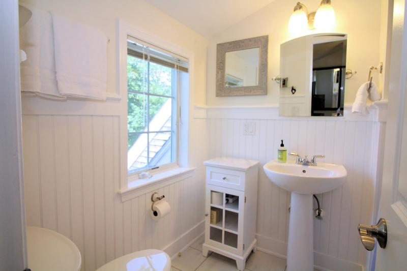 Second floor master en suite bathroom with tub and shower