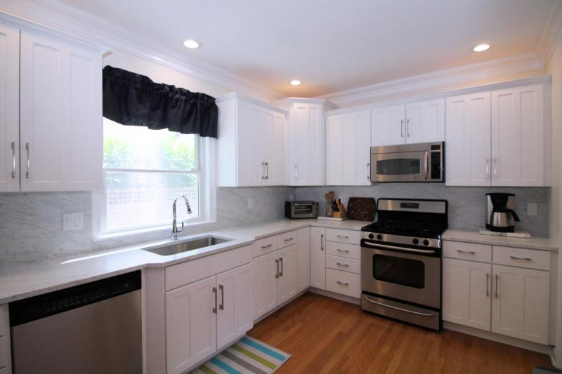 Kitchen has custom marble counter tops and stainless appliances