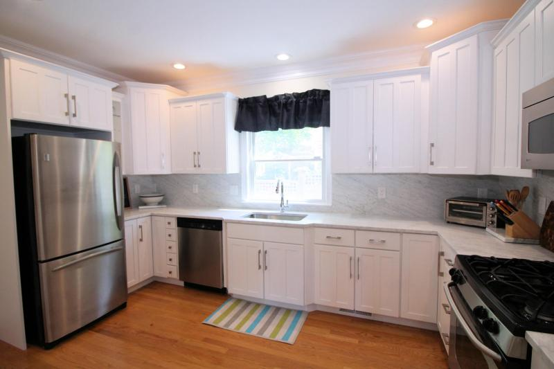 Kitchen has stainless appliances and is bright and open