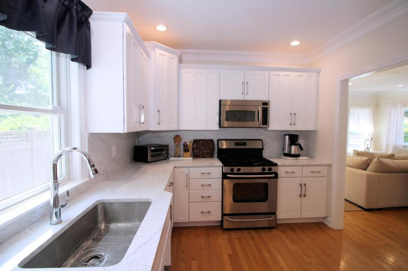 Well equipped kitchen with custom marble counter tops