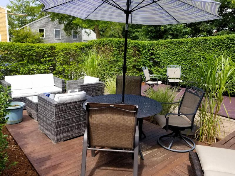Enjoy the private front yard with comfortable furniture