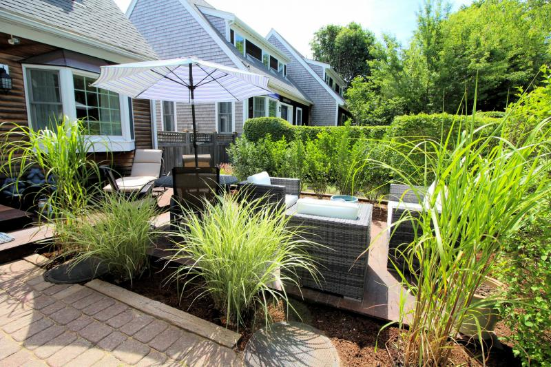 Front outdoor space has dining and lounging furniture
