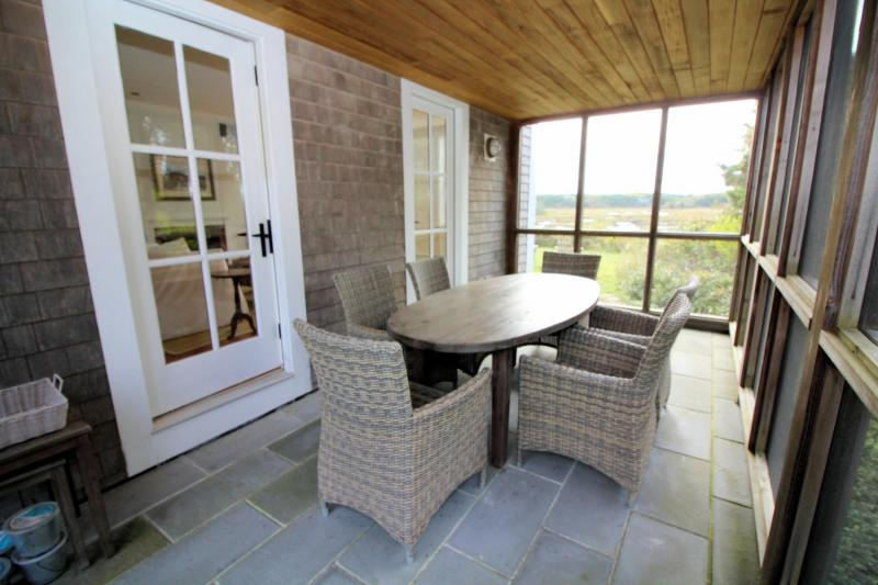 Enjoy meals on the beautiful screen porch