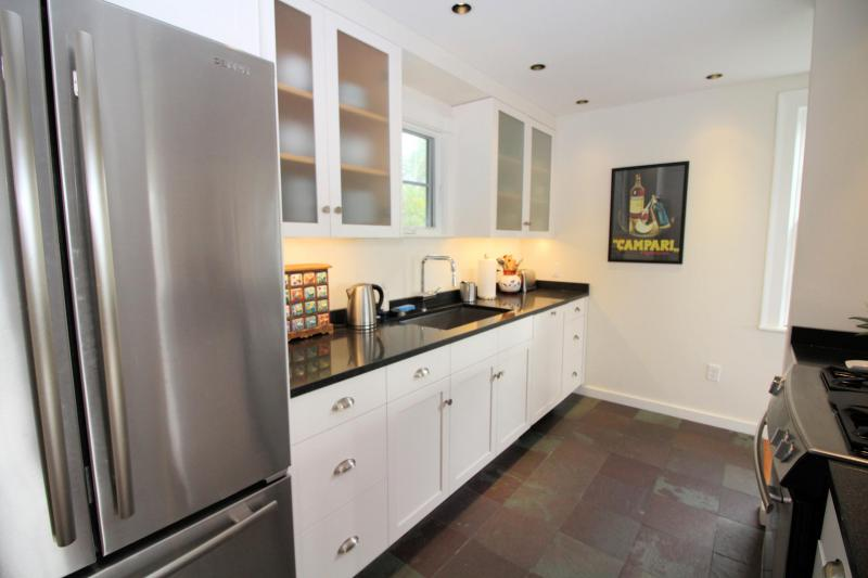 Kitchen has nice appliances including a dishwasher