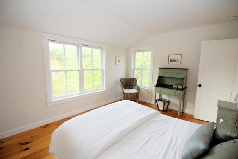 Fourth bedroom with queen bed on second floor