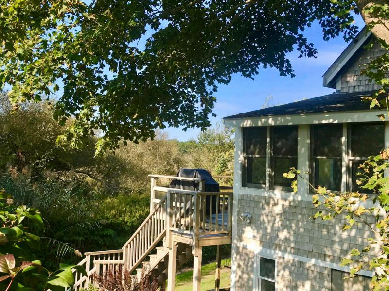 Walk to town center or the harbor from this marshland cottage