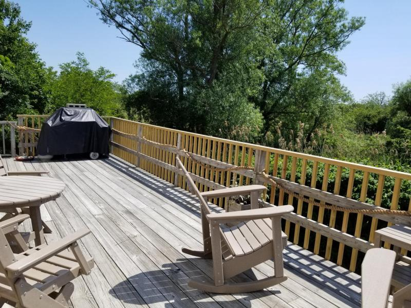 Lovely deck with outdoor furniture and gas grill