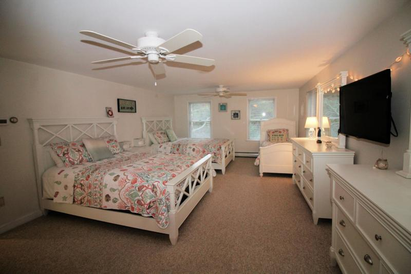Second floor bedroom with queens and twin has a TV with cable an