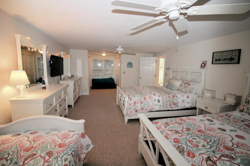 Second floor bedroom with two queens and a twin