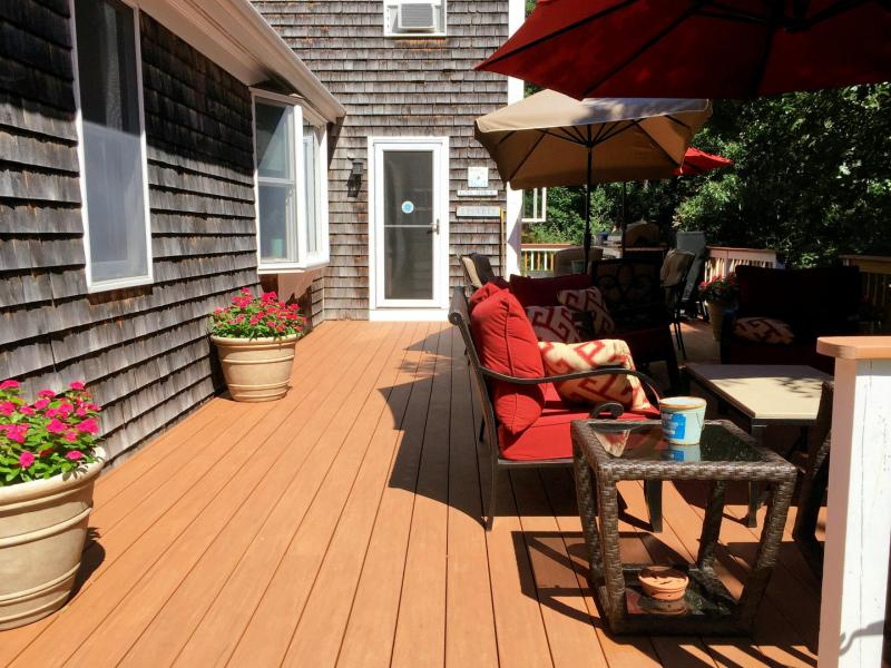 Large deck with outdoor furniture and gas grill