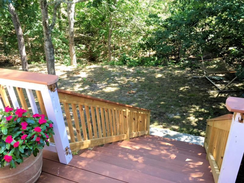 Stairs lead from deck to lower patio