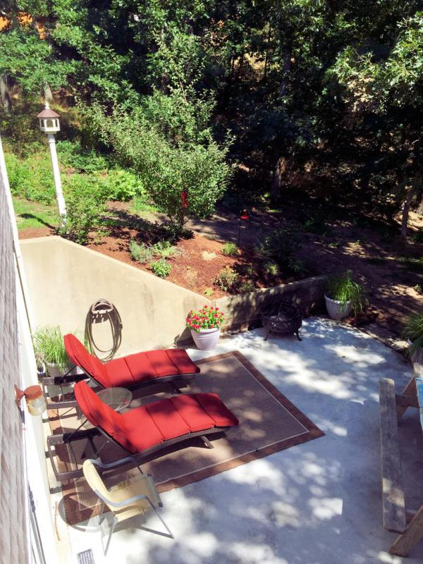 Patio has comfortable furniture and a fire pit