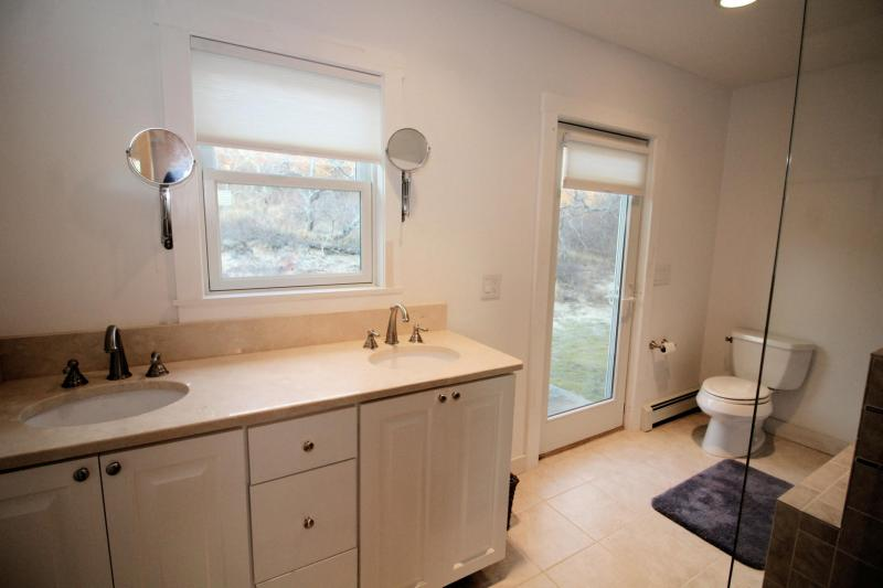 First floor en suite bathroom with double sinks