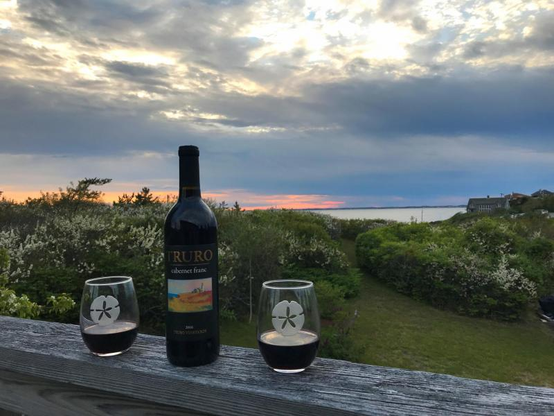 Enjoy the sunset and a glass of wine on the deck