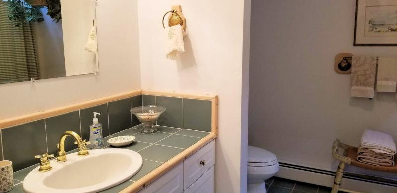 First floor bedroom en suite bathroom with separate tub and show