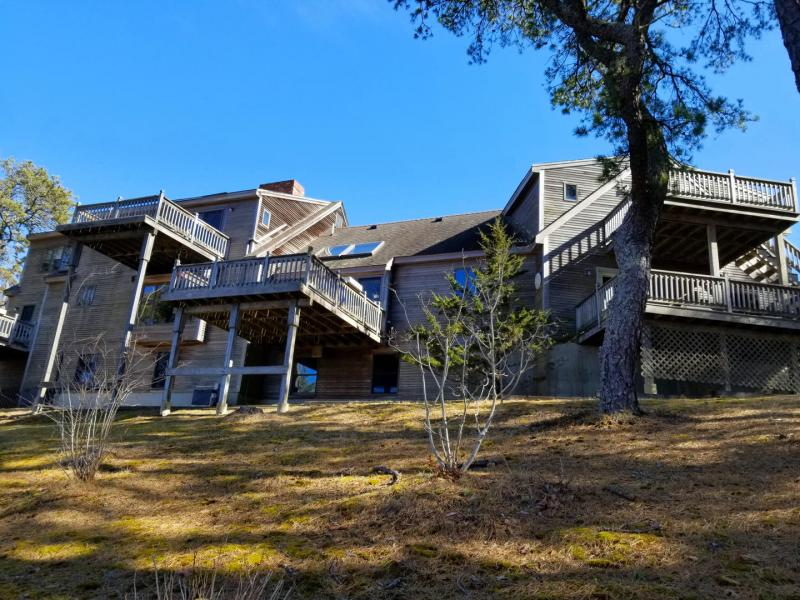 Home features several decks that face the marsh