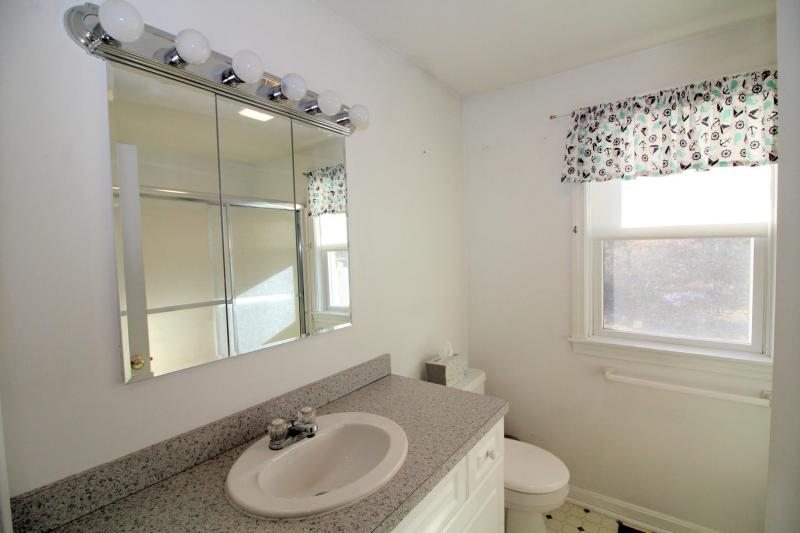 First floor bathroom with shower and tub