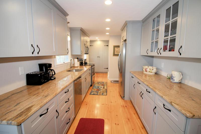 Beautiful kitchen with granite counter tops and stainless applia