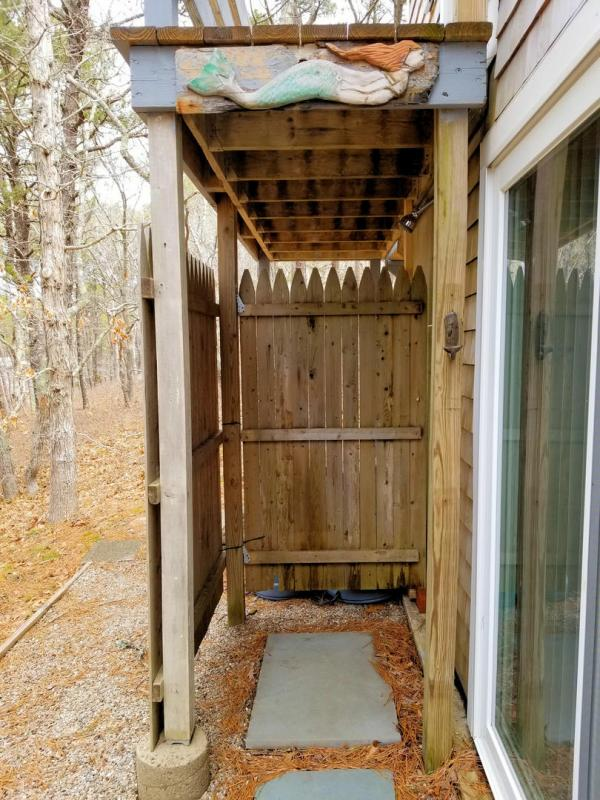 Enclosed outdoor shower with curtain