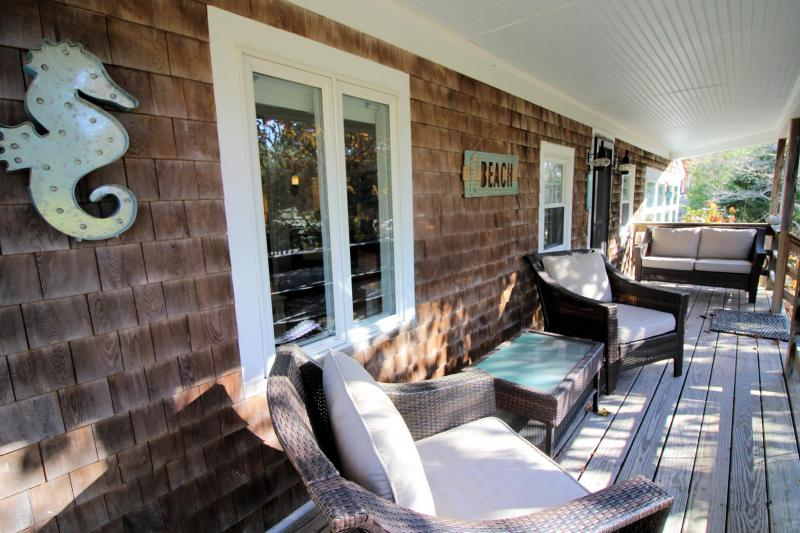 Sip your coffee on the charming front porch