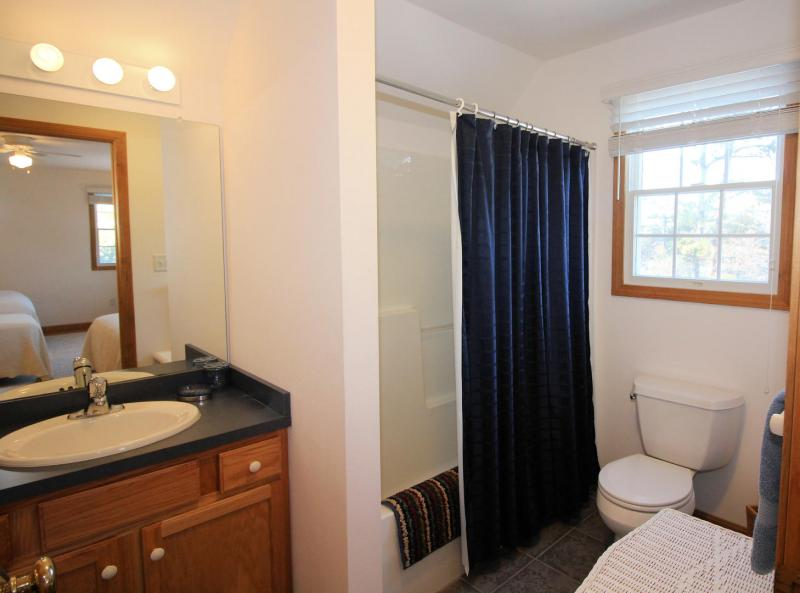 En suite bathroom with tub and shower in second floor bathroom
