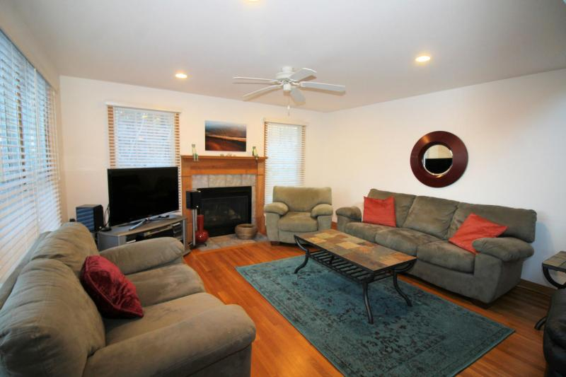 Cozy living room has a gas fireplace and flat screen TV