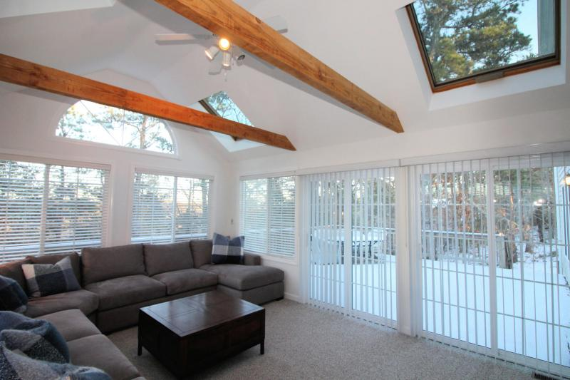 Wonderful sun room with skylights and slider to deck