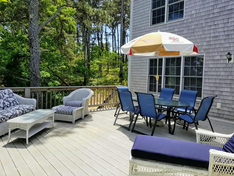 Deck with outdoor furniture and wooded view
