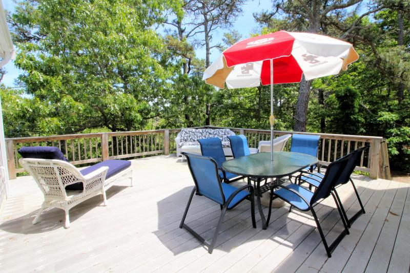 Enjoy beautiful wooded views on the deck