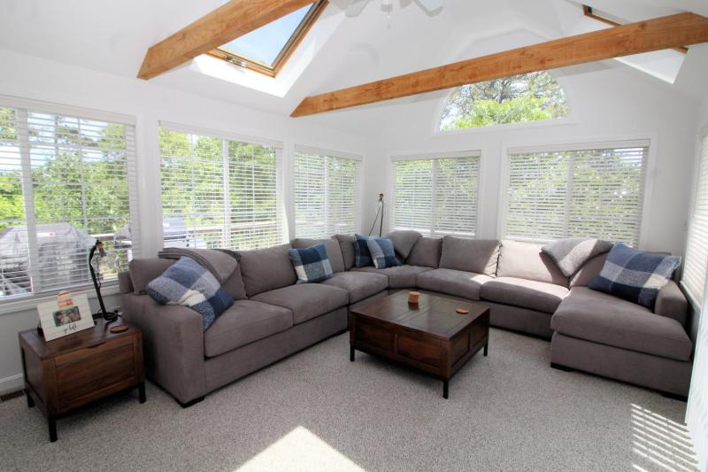 Wonderful sun room with comfortable sectional