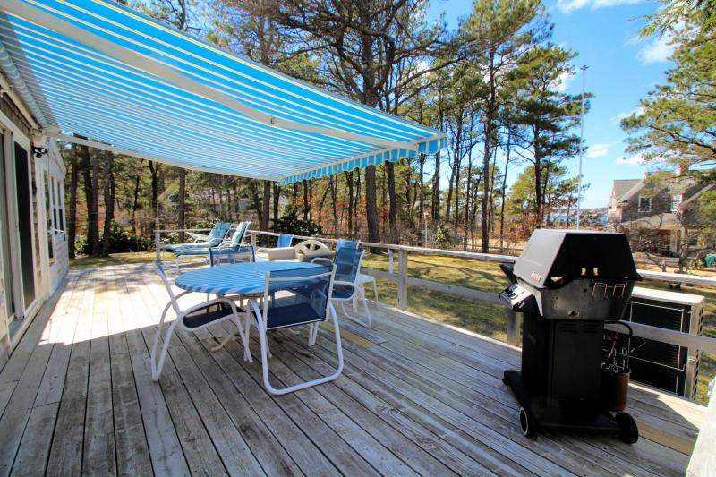 Deck has a retractable awning and gas grill